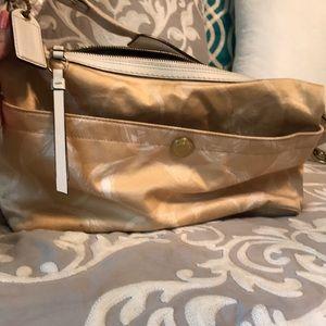 Champagne colored Coach shoulder bag